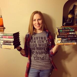 holding up a dozen books